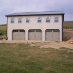 pole barn garage with 3 doors