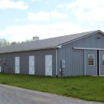 grey horse barn with double front door