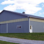 large grey horse barn