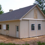 newly built tan horse barn