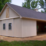 tan horse barn with asphalt shingle roof