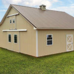 tan horse barn with metal roof