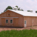 wood horse barn with two cupolas