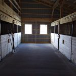 horse stable and concrete floor of newly built pole barn interior