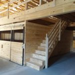horse stables and steps leading to second floor of pool barn building